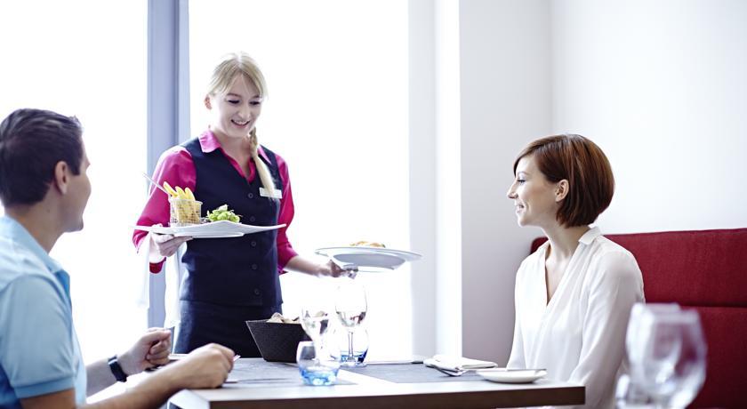 Novotel Ipswich waitress serving meal