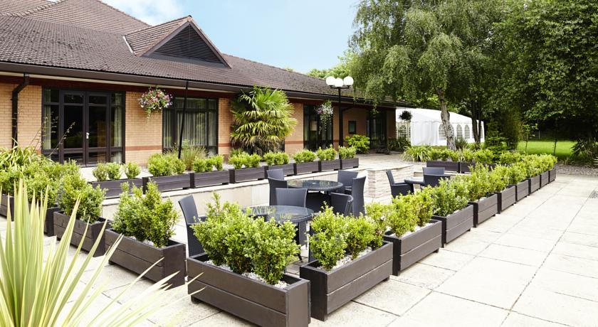Novotel Hotel Manchester with seating outside