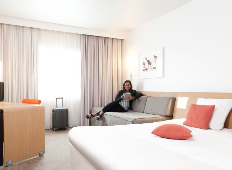 Novotel Hotel Newcastle, Bedroom & lady on iPad