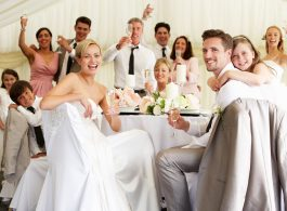 Wedding bride and groom celebrating with guests at reception