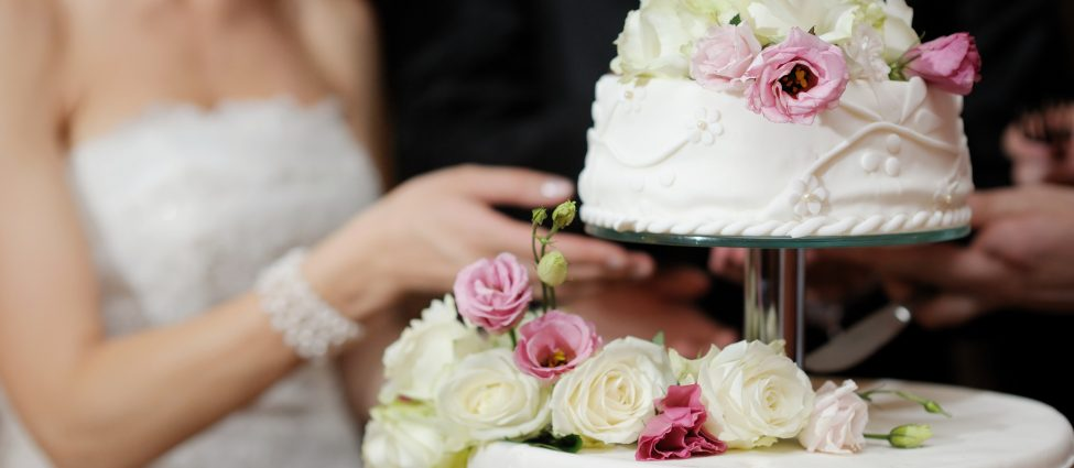 Weddings bride cutting cake